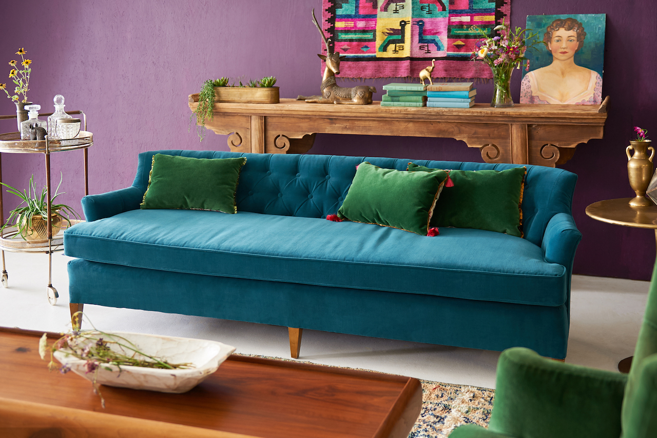 Jewel tones! Our deep teal Martin Sofa with green velvet Sinead chairs + pillows. Alter table, daschund coffee table + Moroccan rug # 32.