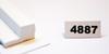 "4887   -   Plastic termination strips, 1/4"" x 1/4"" x 5', w/leg, double sided tape"