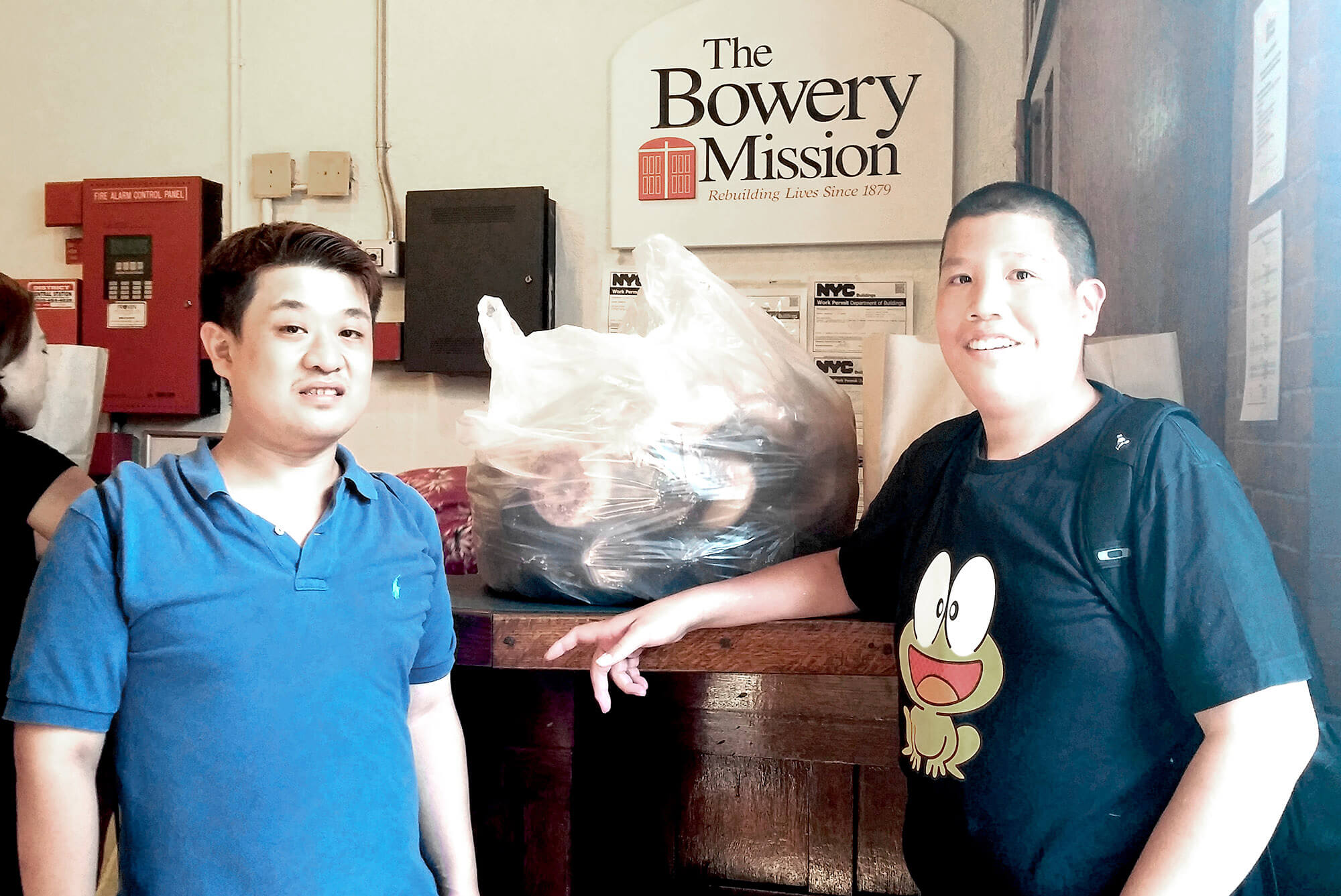Frankie chan and liang yang at the bowery mission