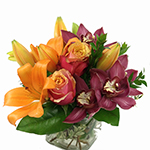 Image of A small arrangement with big style made possible by the premium orchids and Cherry Brandy Roses.