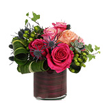Image of Rosabela is a beautiful assortement of 8 roses in tones of pink. Arranged in our heavy glass cylinder vase lined with coordinating faux aspidistra which hides the stems, this beautiful bouquet dazzles with texture and tone. See Rosana to change the container.