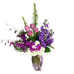 Image of Jolán Bouquet is an collection of our most popular purple and lavender flowers such as Ecuadorian Roses, Dendrobium Orchid from Malaysia and beautiful Central Coast Stock arranged in a base of white Hydrangea in a heavy, keepsake vase.