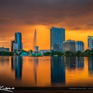 Sunset Downtown Orlando Florida with Lake Eola Water Fountain during a sunset with stormy clouds. HDR image created in Aurora HDR software by Macphun.