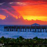 Juno Bach Pier at Sunrise Breaking Through Storm