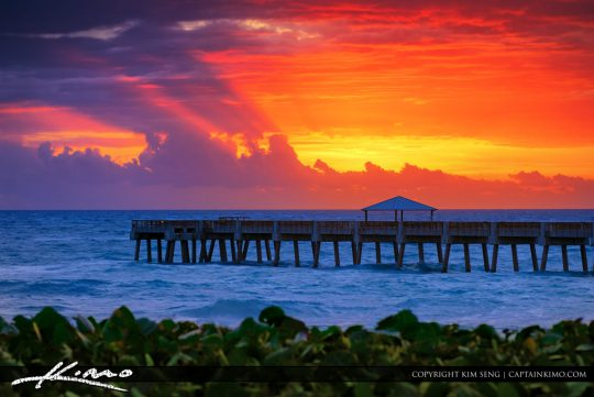 Juno Bach Pier at Sunrise Breaking Through Storm