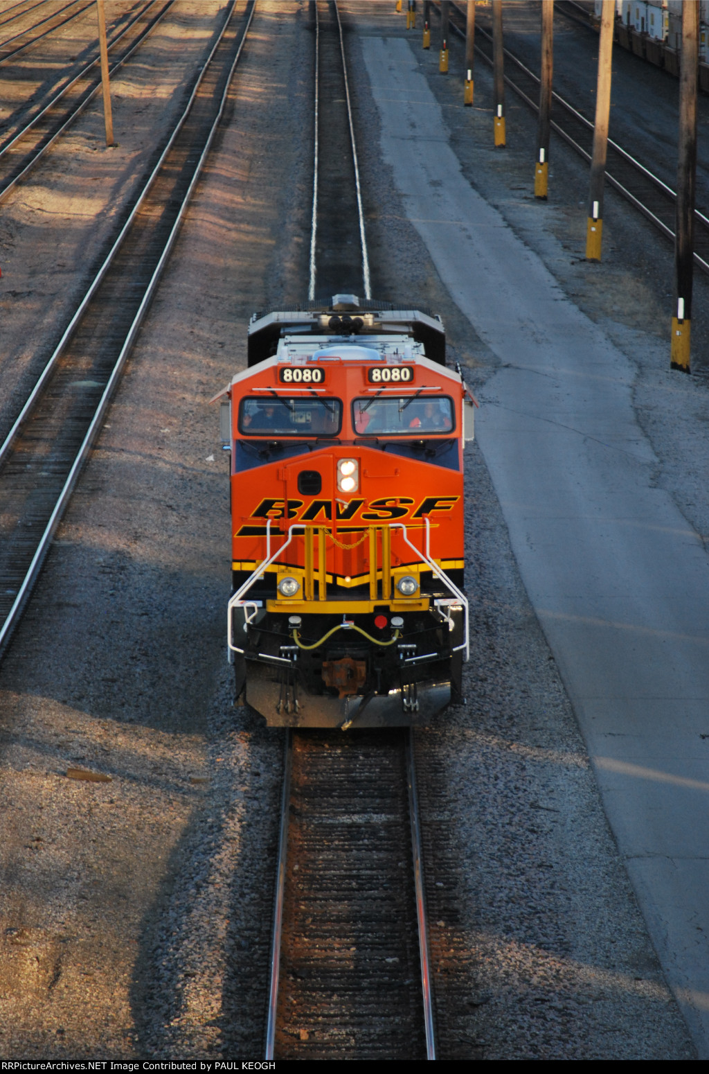 BNSF 8080 heads down Main Track #3 on Her way to be a add on Locomotive to a east or west Z or Stack Train.