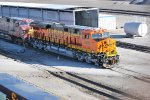 BNSF 8080 rolls past the washing facility at BNSF Argentine Yard as the Hostlers spot both BNSF 8080 and BNSF 606
