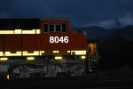 BNSF 8046 Side Shot of the Cab as the Flash Lights Up Her Reflective Road Number and ES44C4.