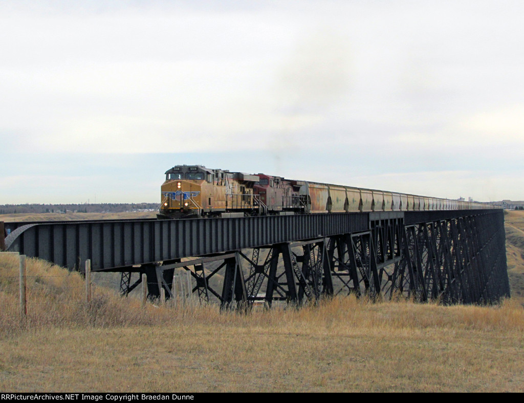 UP 5518 heads CP 673 at Lethbridge
