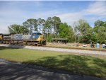 CSX 84 and CSX 7625 leads Q155-05 past The Folkston Platform