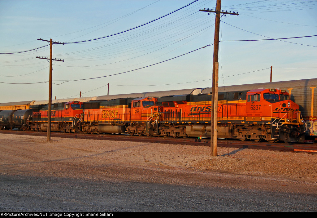 BNSF 6337 Sits with a freight train at the NS.