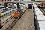BNSF 7460 Leads a Q train while they meet a Q train..
