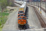BNSF 7388 Snakes a stack train East through Argentine yard.