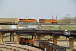 BNSF 7023 Leads a Auto rack over top a loaded coal train.