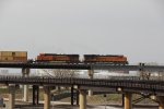 BNSF 7518 Rocks a EB stack train on the flyover.