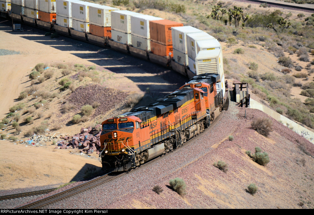 "BNSF 6605 at the ""over/under"" at Frost"