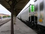 Coal cars speeding past the station platforms,