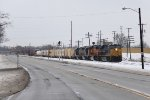 Rolling alongside an empty Chicago Dr, Q326-11 starts to slow as it nears Wyoming Yard
