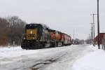 CSX 4007 leads the rerouted Q383-10 west through town toward Wyoming for a crew change
