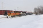 BNSF 4177 & 9765 dig in as they start east with Q334-09