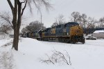 With CSX 334 leading the way, Q334 climbs uphill as it starts the trip to Toledo