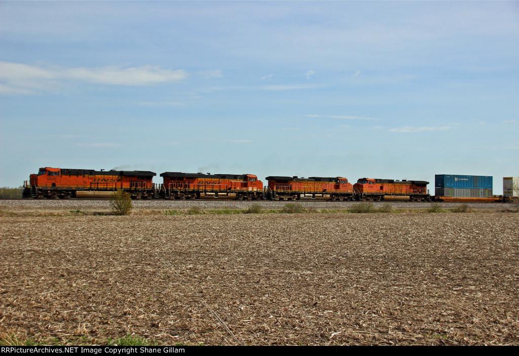 BNSF 6826 Leads a fast moving stack train toward Elmer Mo.