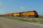 BNSF 7360 Leads a grain train out of Old Monroe Mo..