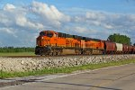 BNSF 6768 Leads a worm train into Old Monroe Mo..