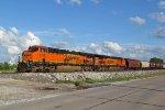 BNSF 6768 Rolls a grain train slow into town..