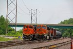 BNSF 6301& BNSF 9168 sit on empty Oil cans.