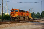 BNSF 5928 Heads a empty coal into the golden sunlight.