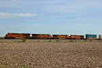 BNSF 6826 Leads a fast moving stack train toward Elmer Mo.