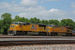 UP 4883 Heads up a SB stack train bound for Dupo IL.