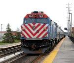 Metra #123 pushing its train to Chicago