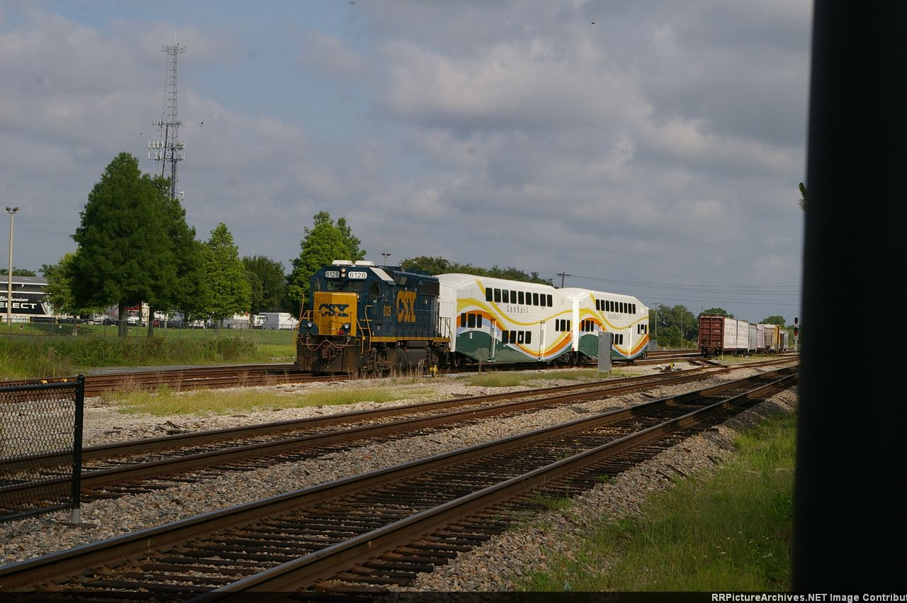 CSX  DELIVEING COACHS TO SUNRAIL