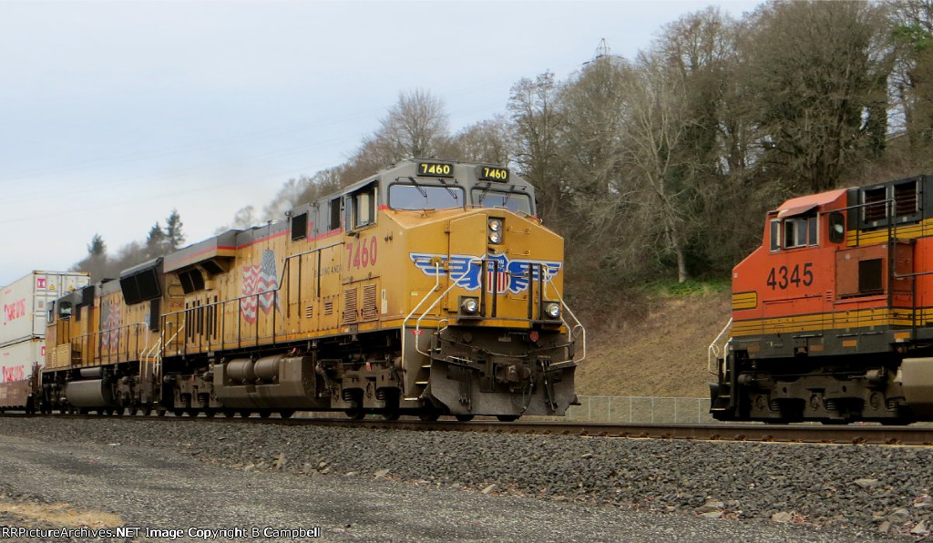 UP 7460 - UP 4748 rushes past BNSF 4345