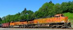 BNSF 4135 and BNSF 7146 pusher pair bring up the rear of a northbound oil can