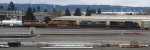 BNSF 6111 - CSX 7785 - CSX 7727 auto-rack on hold being passed (in reverse) by BNSF 2339