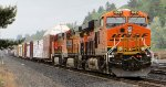 BNSF 6933 leading a southbound consist awaits a green