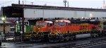 BNSF 7275 (near power holding track), BNSF 1454 (far power corral track), and  BNSF 1401