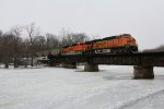 Seconds from starting the climb up Saugatuck Hill, BNSF 6125 & 9010 are working all out as they cross the Kalamazoo River