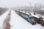 LSRC 6301 brings its Essexville empties down to McGrew while passing snow covered loads for St Clair