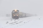As the snowfall gets heavier, G900 goes about doubling its train together