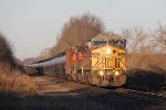 Engines from UP, CN and BNSF lead the oil loads of U720 east on the single track