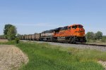 BNSF 9055 & 9571 make track speed as they head west with empty coal buckets from West Olive