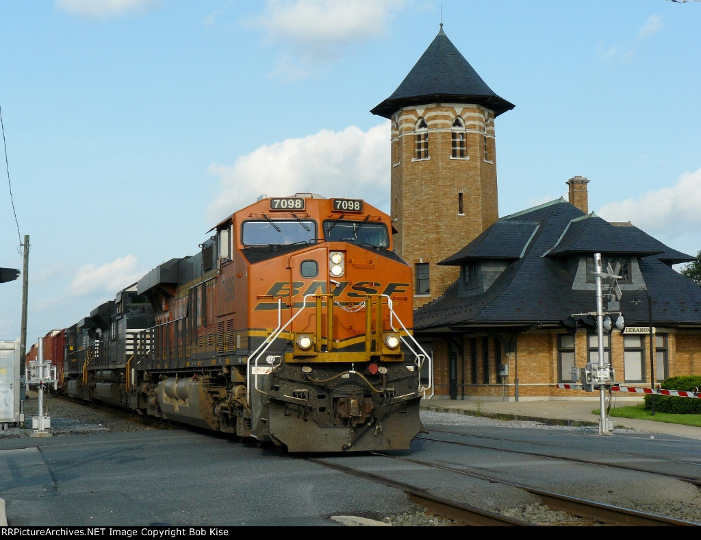 A BNSF unit leads the NS 15T westbound by the old Lebanon station