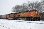 Grain train rolls east
