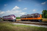 ACL 501, EMD E3, and IP 515, EMD E8, both built by EMD 14-years apart,