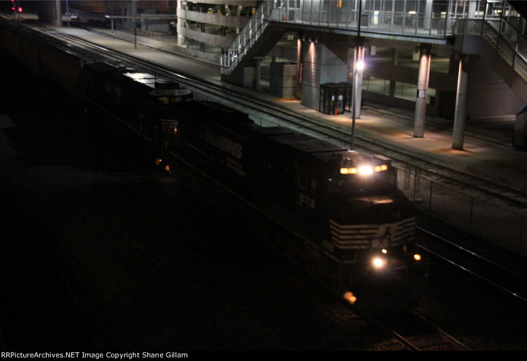 NS 9712 leads a WB Up freight past Union Station.