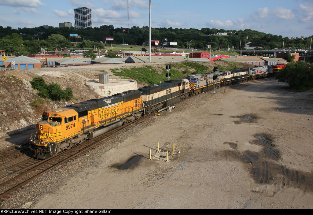BNSF 9974 Heads up a very colorfull empty coal train..